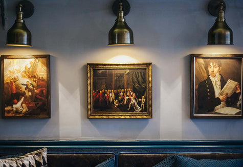Star and Garter restaurant interior with navy decor, unique wall art and industrial wall lights