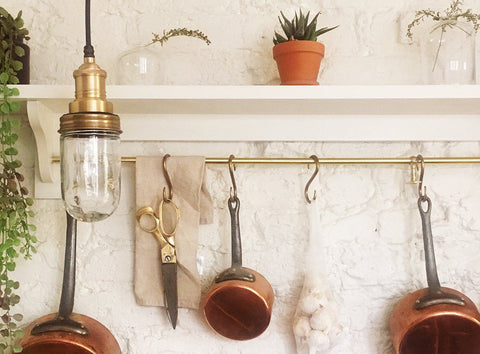 Brass waterproof pendant in a kitchen decor