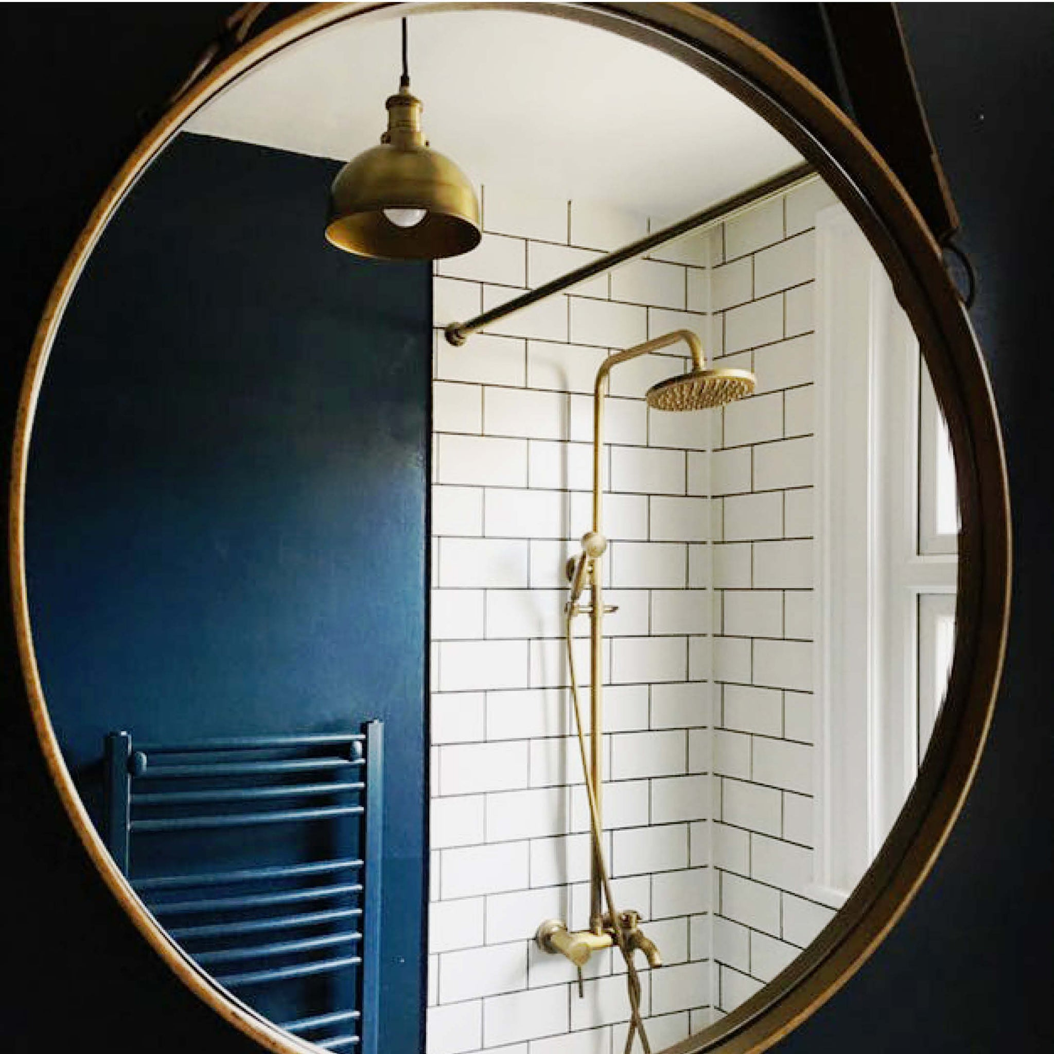 Brass toned interior complementing dark walls