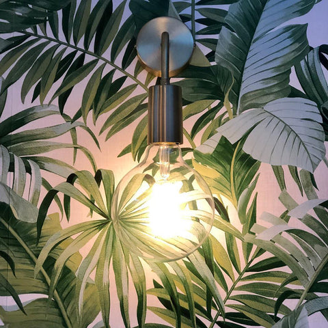 Pewter wall lights on a tropical wallpaper wall