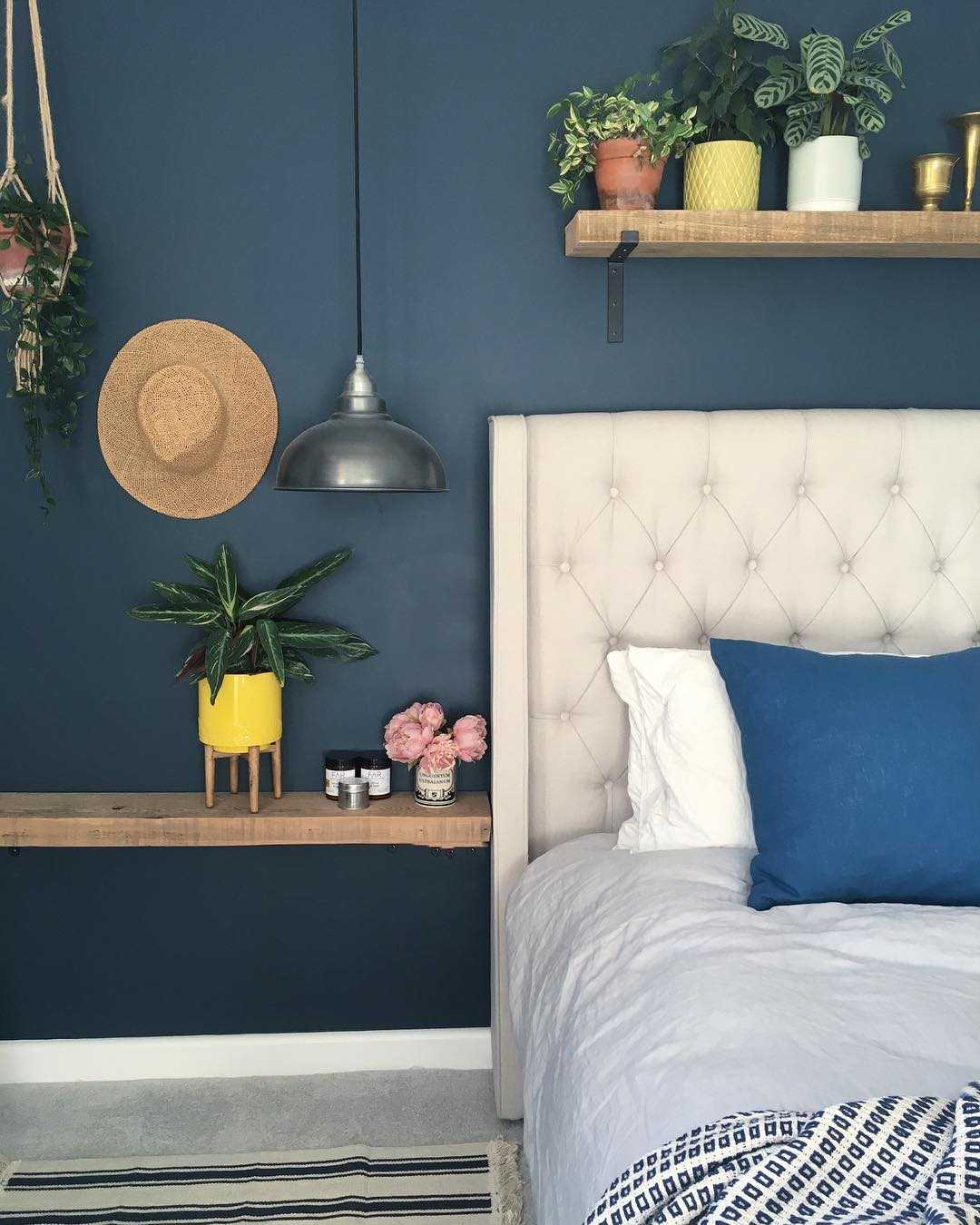 Blue bedroom interior with pewter lights