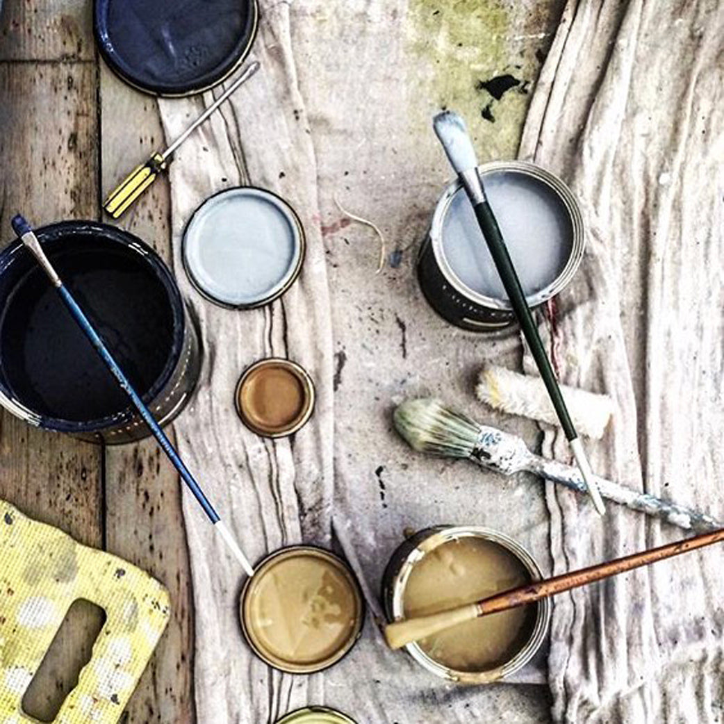 Shabby chic paint pots and paintbrushes