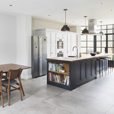 Kitchen interior with dark cabinets and pewter pendants