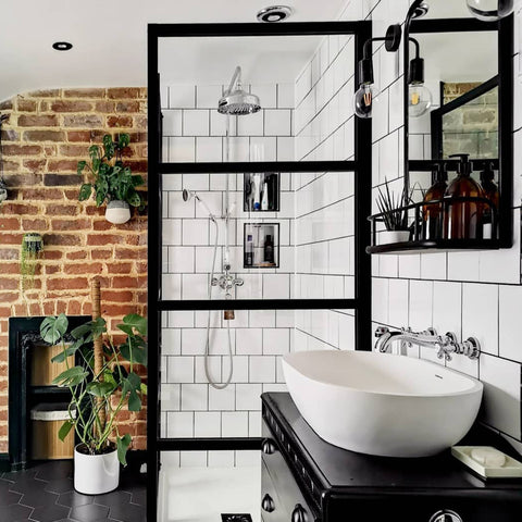 Industrial inspired bathroom interior with pewter wall light