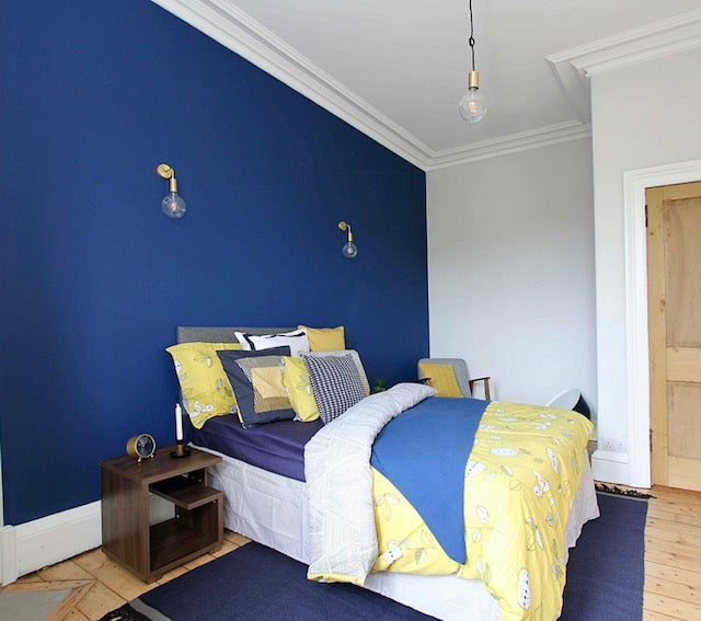 Bright blue and yellow bedroom interior decor