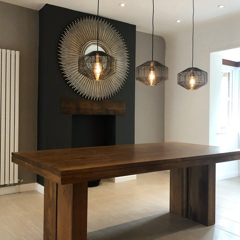 Japandi inspired dining room interior with handcrafted pendant lights