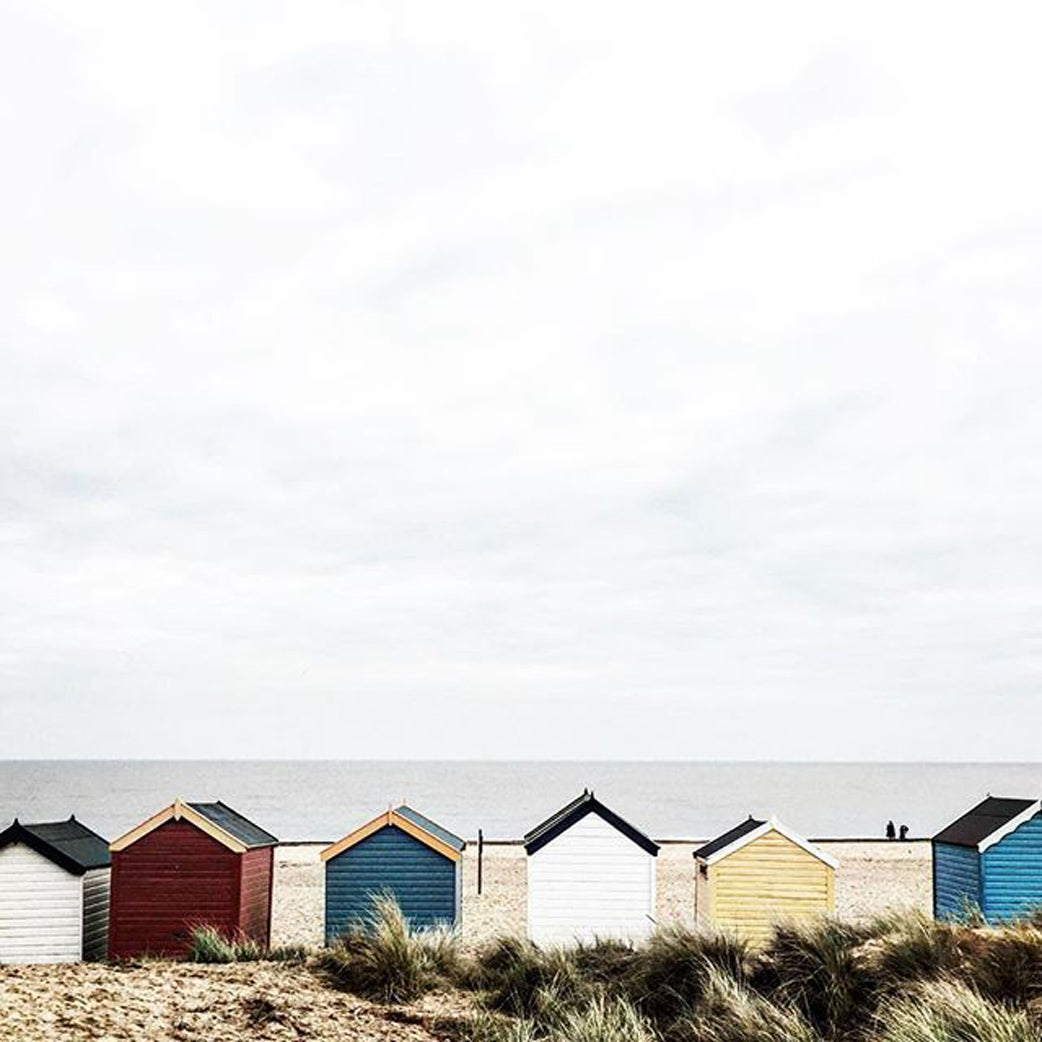 Old fashioned, coloured beach huts on the beach