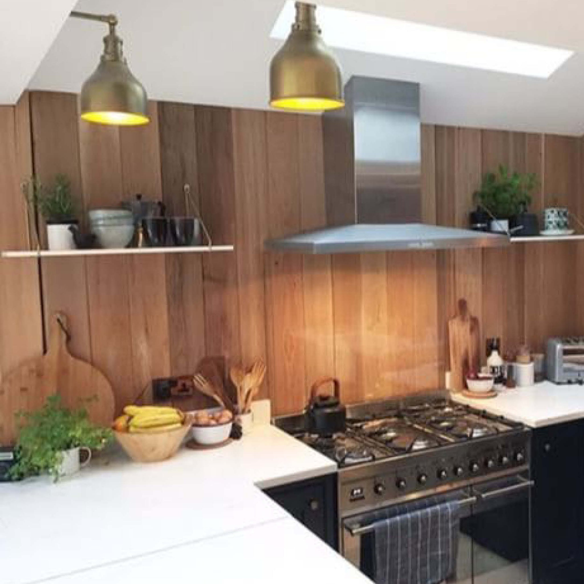 Brass industrial lights in kitchen