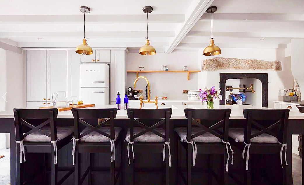 Kitchen interior design with trio of metallic lights