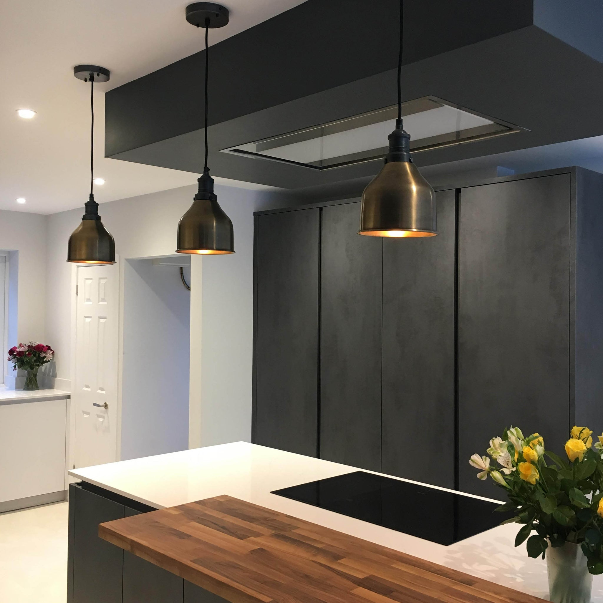 Dark kitchen interior with industrial lights over kitchen island
