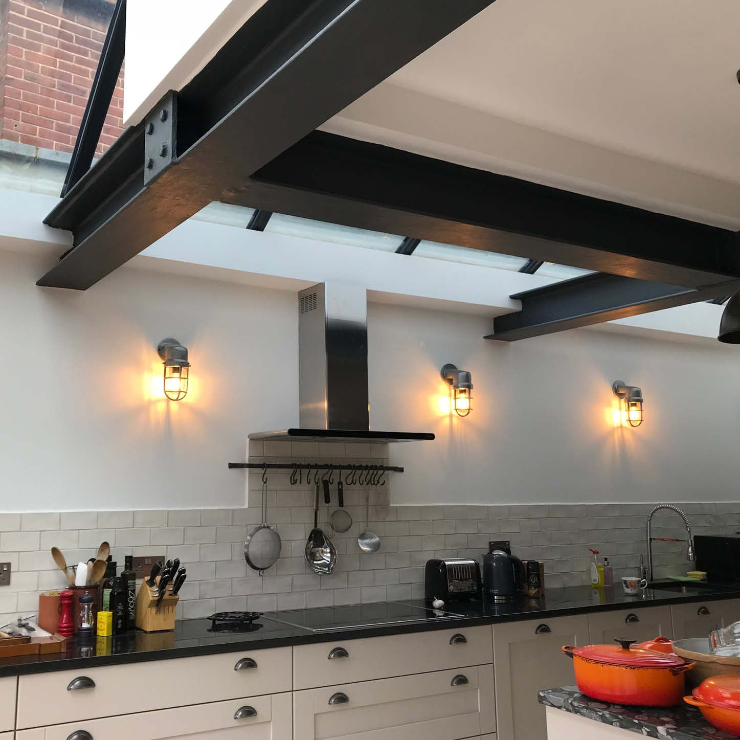 Kitchen with skylights and dark metal beams