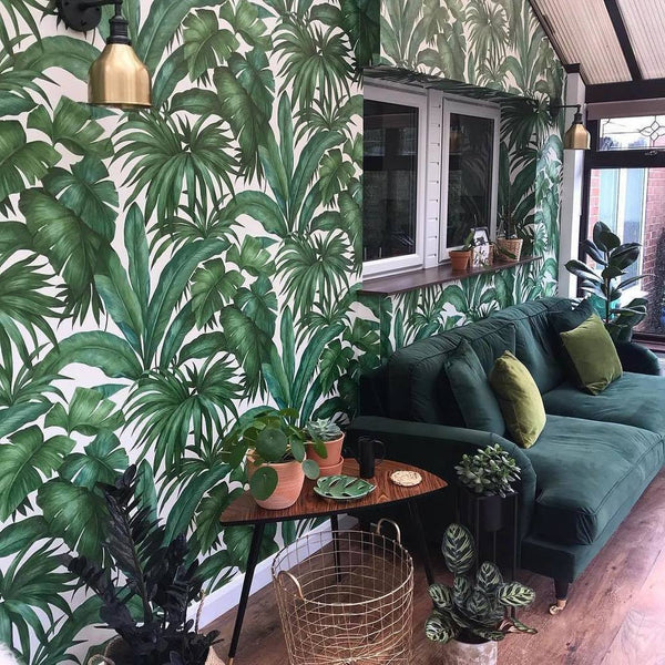 Green leaf wallpaper in a green living room
