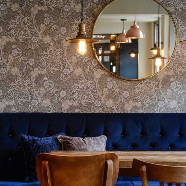 A luxurious dining area in a hotel with floral wallpaper