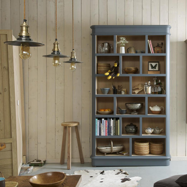 A living room with pendant lights and bookcase