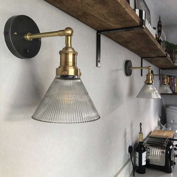 Glass funnel wall lights in a kitchen
