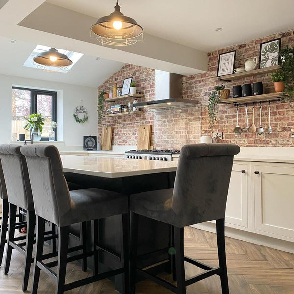 An industrial kitchen with luxury island chairs