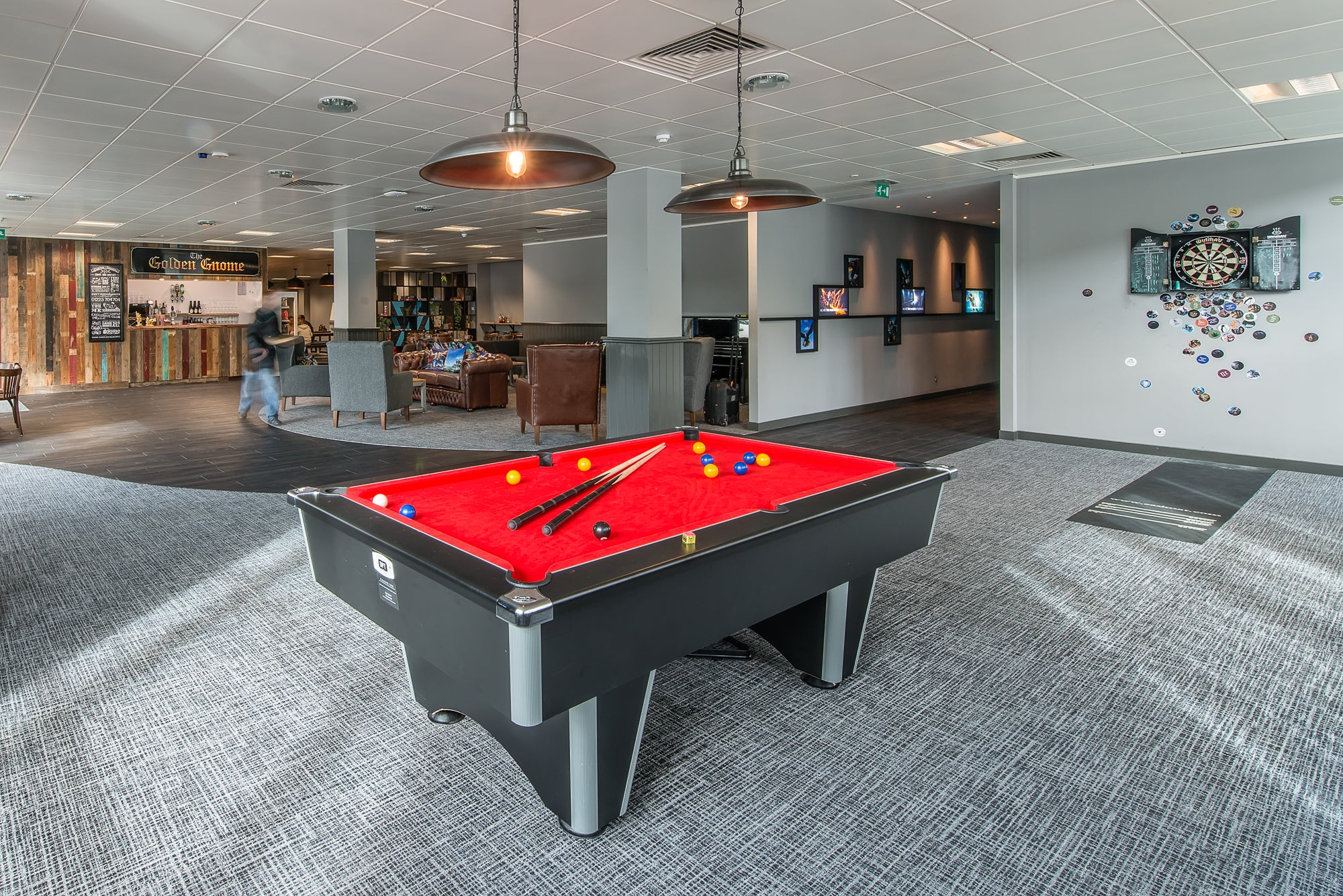 Pool table in office with retro lighting