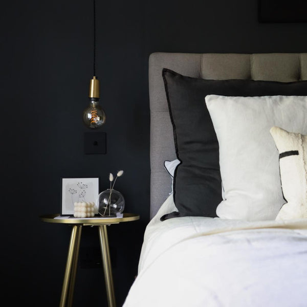 A modern bedroom with black walls