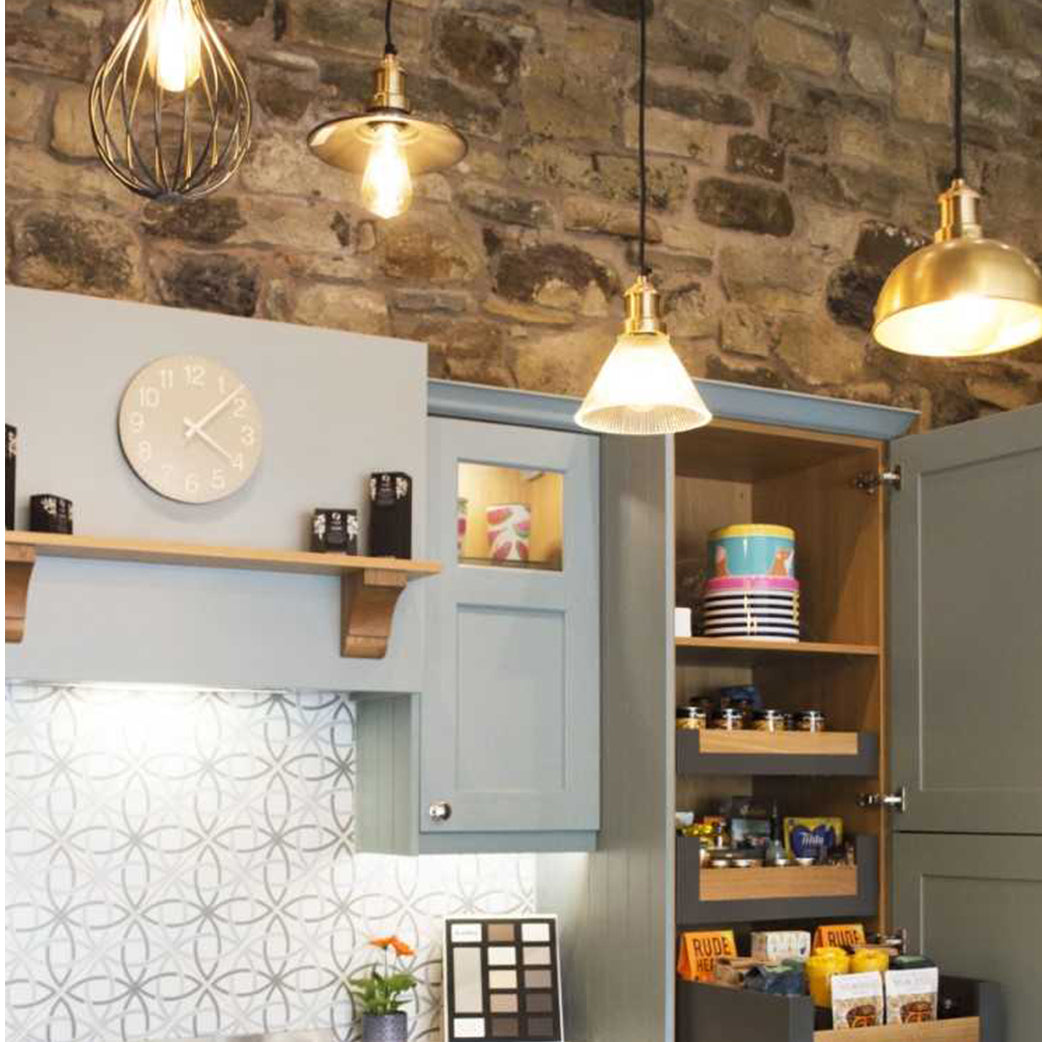 Kitchen with stone walls and hanging lights