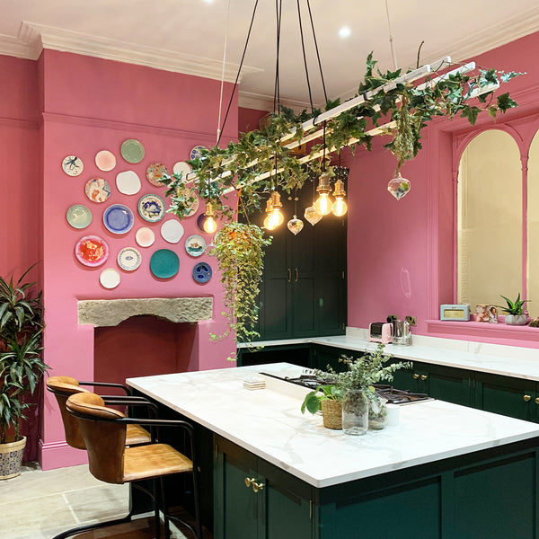 A pink kitchen with botanical decorations