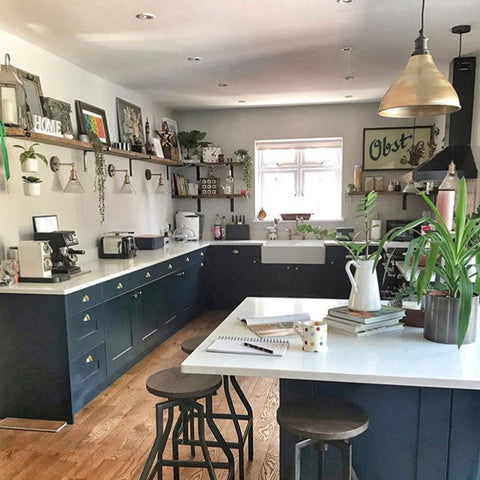 A modern rustic kitchen with dark blue fittings