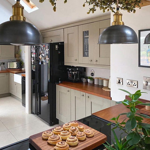 A stylish kitchen with a board of cinnamon rolls