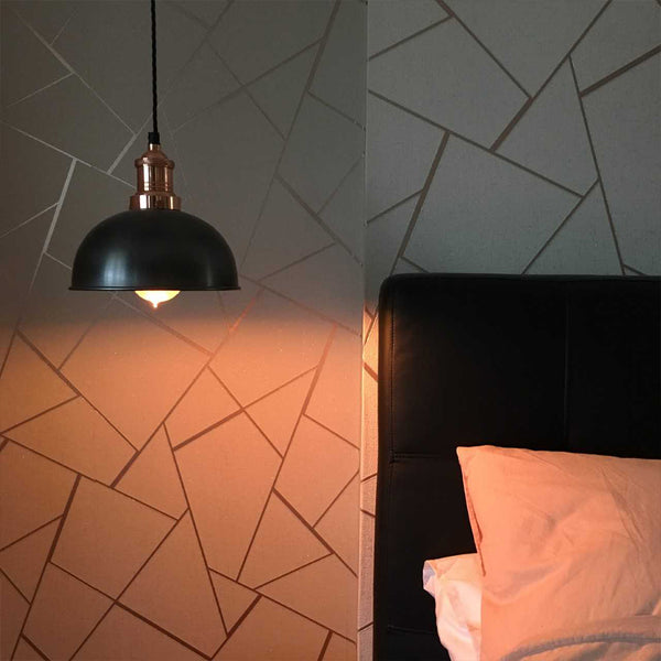 A modern bedroom with patterned wall and hanging light