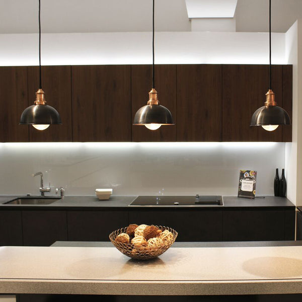 A modern kitchen with hanging lights by Industville
