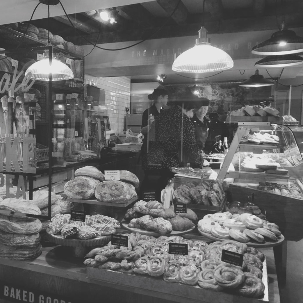 black and white bakery window with glass lights