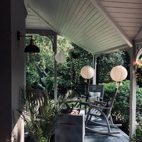 A stylish balcony with metal wall light by Industville