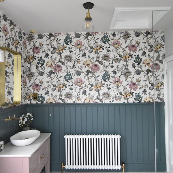 A traditional bathroom with vintage floral print wallpaper