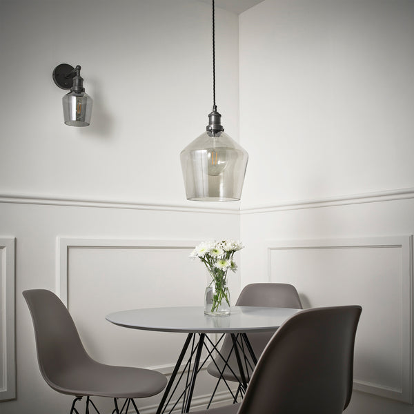 Smoke grey tinted glass shades around a dining table