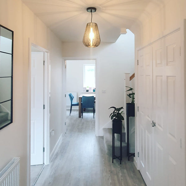 A light hallway with industrial lighting