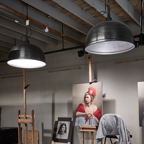 Large hanging industrial lights by Industville at an art studio