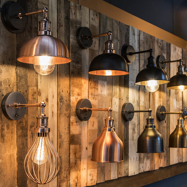 Industville industrial wall lights hanging on a wooden show wall
