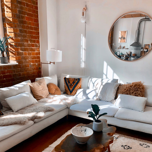 A light living room with wooden features and industrial lighting