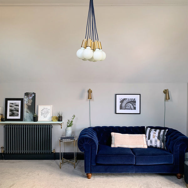 A mid-century modern interior with large hanging lights by Industville
