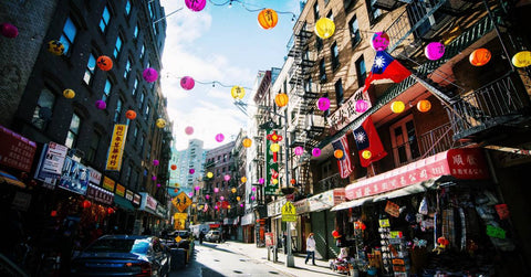 Lanterns strung along Mott Street in NYC Chinatown to remind people that Chinatown is open for business.