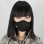 Girl wearing Vogmask mask with N95 filter for pollution allergies germ smoke or dust Small