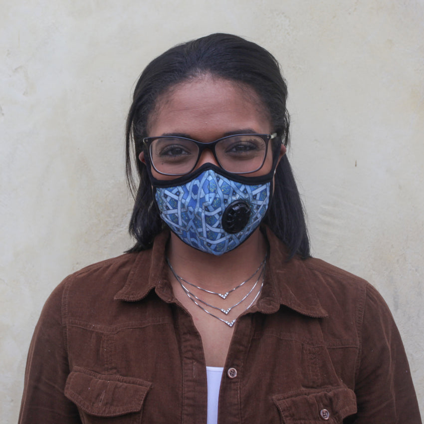 Girl wearing Vogmask mask with N95 filter for pollution allergies germ smoke or dust