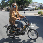 Model wearing Vogmask Genesis VMCV Particle Filtering Mask on a scooter Small