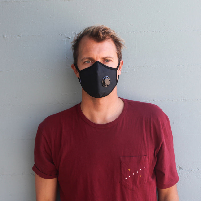 Man wearing Vogmask mask with N95 filter for pollution allergies germ smoke or dust