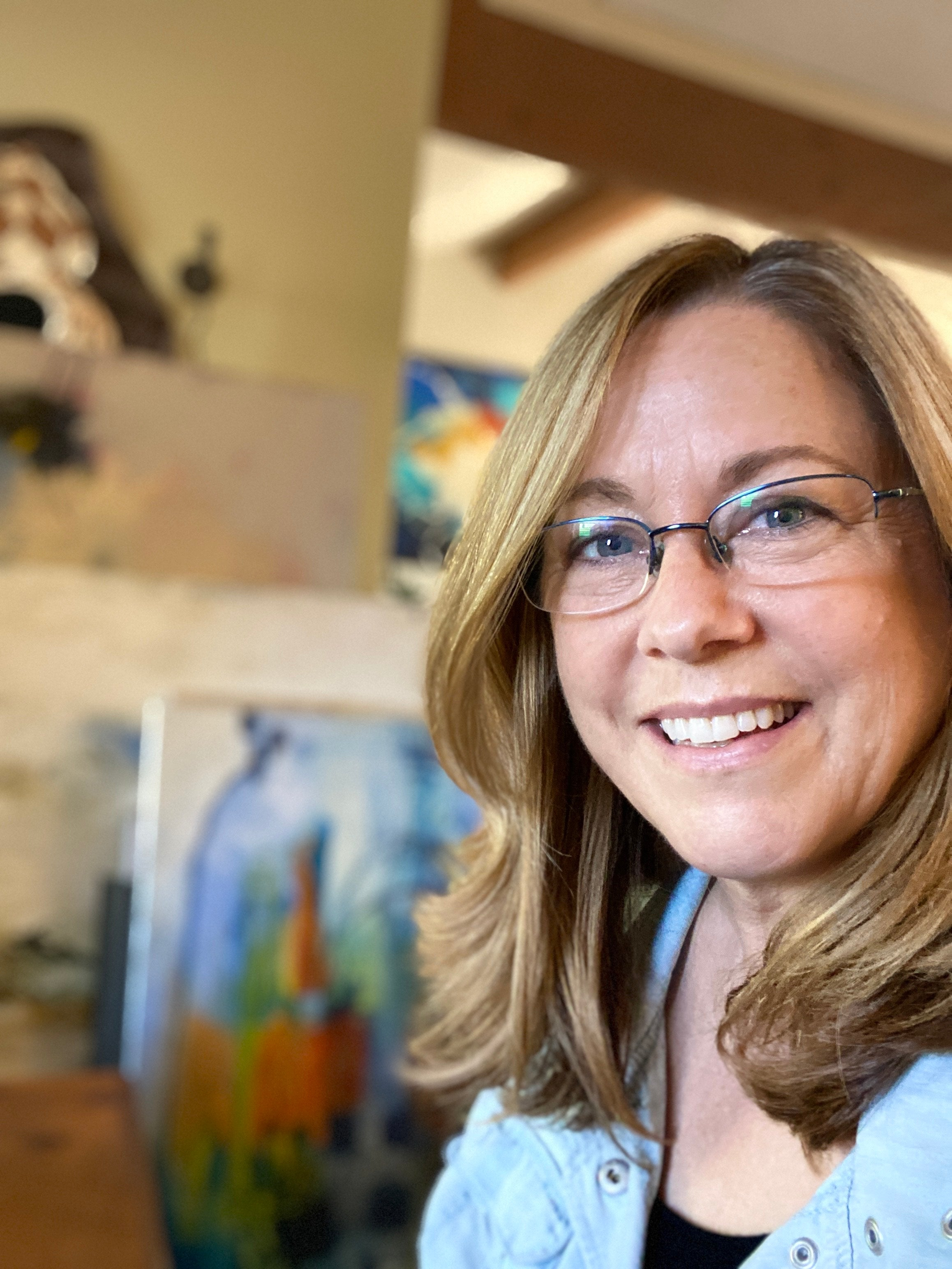A portrait photo of San Diego artist, Susie Zol, who is featured in our store at Bench Home