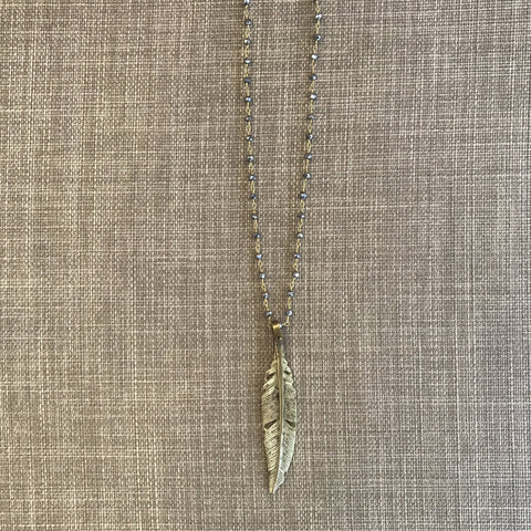 """The Natura Feather Necklace: Brass casted feather with beaded pyrite chain. Approx. 8"""""""