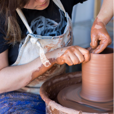 Jess Carter working on a ceramics piece in her workshop