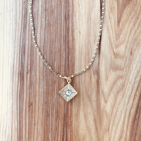 """Gold Lookout Crystal Necklace: Electroplated gold chain. 14kt gold finish over sterling silver pendant with Austrian Crystal. Dimensions: 16"""" + Extension"""
