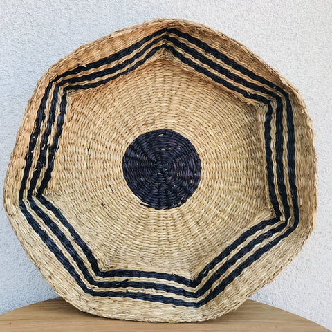 A scalloped seagrass basket perfect for a neutral accent