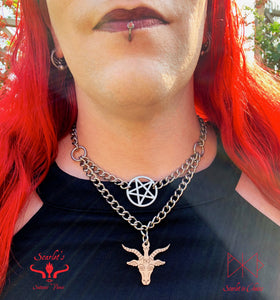 close up shot of double layer stainless steel necklace with a stainless steel inverted pentagram on the top layer and a limited edition baphomet charm on the bottom layer