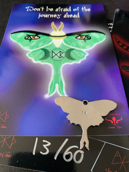 Art card with description and close up of the hand numbering on the luna moth pendant