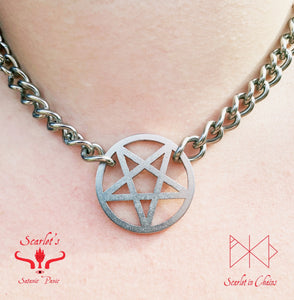 close up of stainless steel pentagram or inverted pentagram charm on stainless steel chain choker
